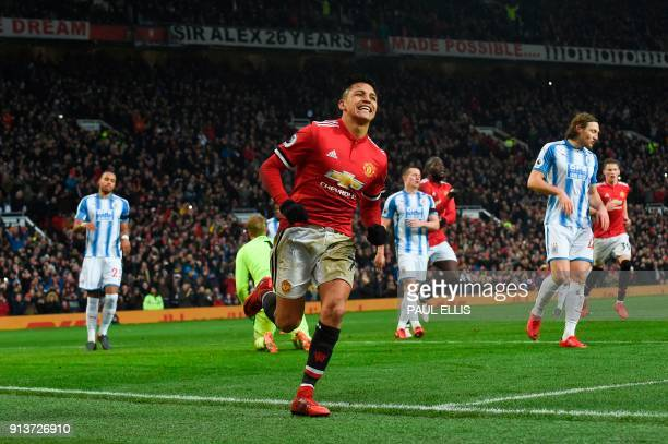 Manchester United's Chilean striker Alexis Sanchez celebrates scoring their second goal during the English Premier League football match between...