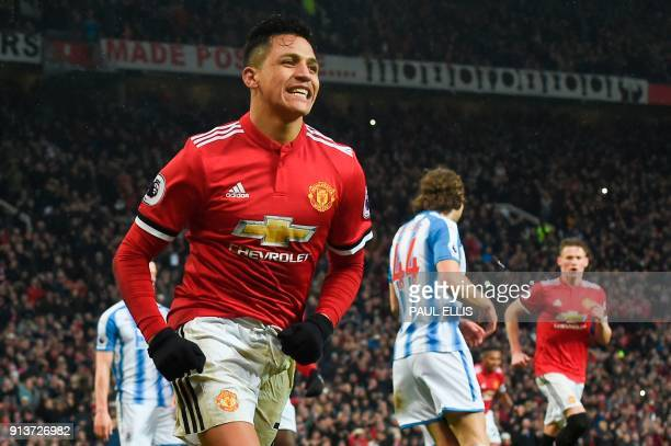 TOPSHOT Manchester United's Chilean striker Alexis Sanchez celebrates scoring their second goal during the English Premier League football match...