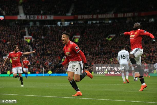 Manchester United's Chilean striker Alexis Sanchez celebrates scoring the team's second goal during the English Premier League football match between...