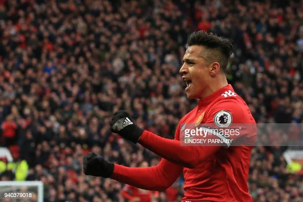 TOPSHOT Manchester United's Chilean striker Alexis Sanchez celebrates scoring the team's second goal during the English Premier League football match...