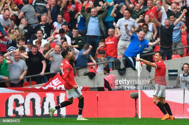 Manchester United's Chilean striker Alexis Sanchez celebrates scoring their first goal to equalise 11 with Manchester United's English midfielder...