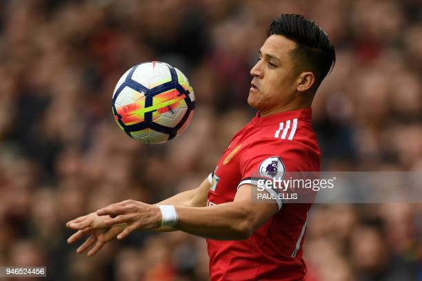 Manchester United's Chilean striker Alexis Sanchez controls the ball during the English Premier League football match between Manchester United and...