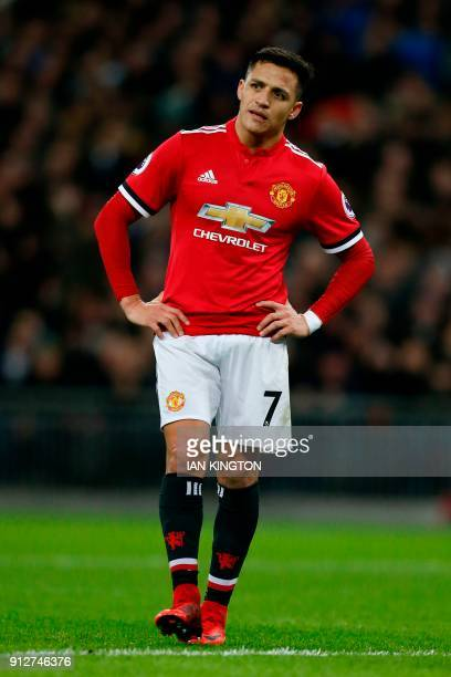 Manchester United's Chilean striker Alexis Sanchez reacts as he waits for a corner to be taken after United went down 20 in the first half of the...