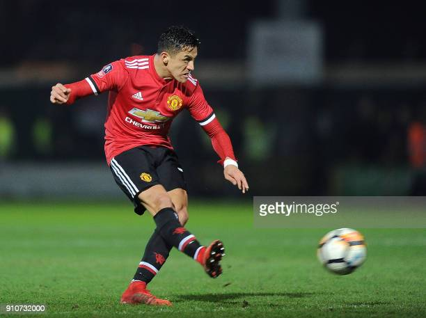 Manchester United's Chilean striker Alexis Sanchez takes a shot at goal during the FA Cup fourth round football match between Yeovil Town and...