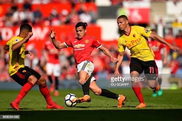 Manchester United's Chilean striker Alexis Sanchez takes on Watford's Englishborn Jamaican defender Adrian Mariappa and Watford's Brazilian striker...