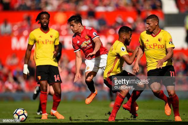 Manchester United's Chilean striker Alexis Sanchez takes on Watford's English midfielder Nathaniel Chalobah Watford's Englishborn Jamaican defender...
