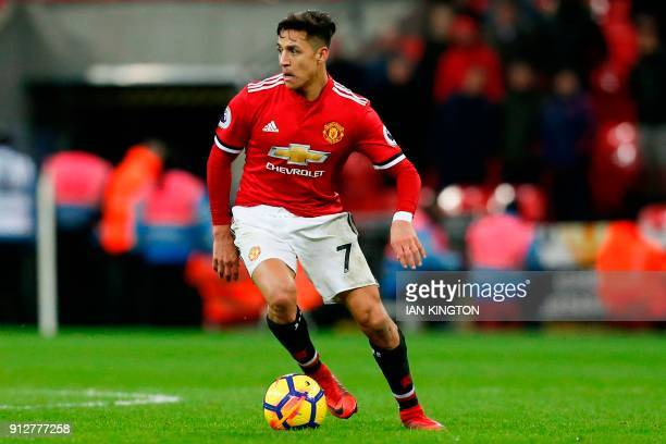 Manchester United's Chilean striker Alexis Sanchez turns on the ball during the English Premier League football match between Tottenham Hotspur and...