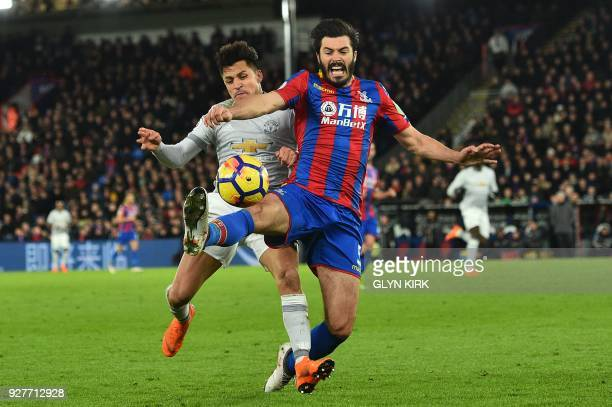 TOPSHOT Manchester United's Chilean striker Alexis Sanchez vie with Crystal Palace's English defender James Tomkins during the English Premier League...