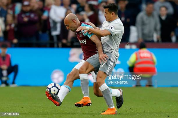 Manchester United's Chilean striker Alexis Sanchez vies with West Ham United's Argentinian defender Pablo Zabaleta during the English Premier League...