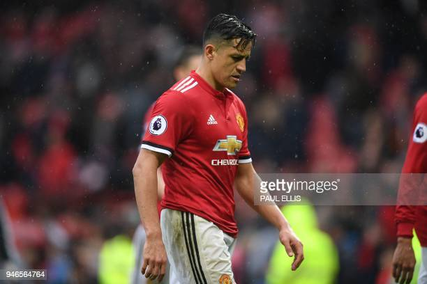 Manchester United's Chilean striker Alexis Sanchez walks off after the English Premier League football match between Manchester United and West...