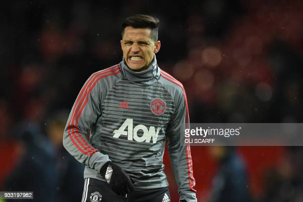 Manchester United's Chilean striker Alexis Sanchez warms up before the English FA Cup quarterfinal football match between Manchester United and...