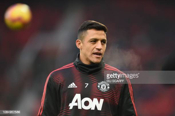 Manchester United's Chilean striker Alexis Sanchez warms up for the English Premier League football match between Manchester United and Brighton and...