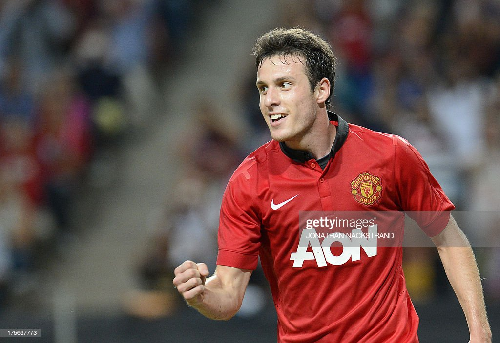 Manchester United's Chilean striker Angelo Henriquez celebrates after scoring during the friendly football match AIK vs Manchester United on August 6, 2013 at the Friends Arena in Solna, near Stockholm, Sweden as part of the Manchester United 2013 pre-season tour.