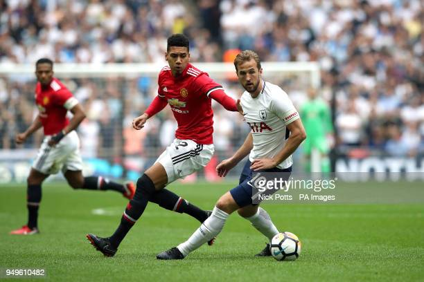 Manchester United's Chris Smalling and Tottenham Hotspur's Harry Kane battle for the ball during the Emirates FA Cup semifinal match at Wembley...