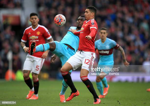 Manchester United's Chris Smalling and West Ham United's Emmanuel Emenike battle for the ball