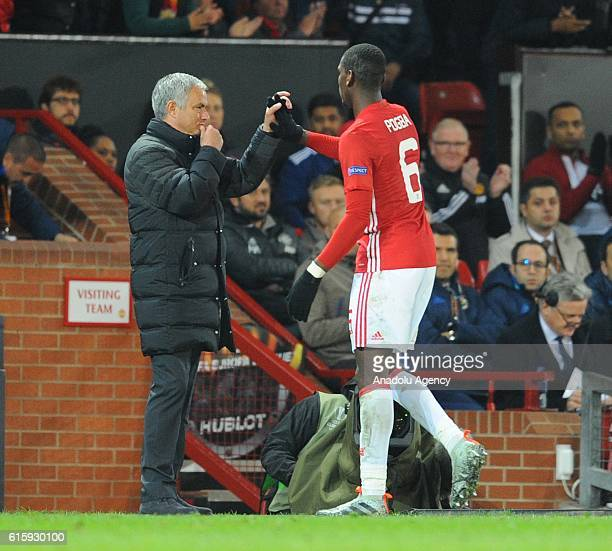 Manchester United's coach Jose Mourinho greets Paul Pogba during the UEFA Europa League Group stage soccer match between Manchester United and...