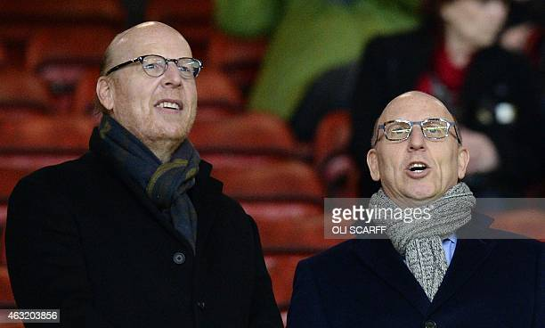 Manchester United's co-chairmen Joel Glazer and Avram Glazer prepare to watch the English Premier League football match between Manchester United and...