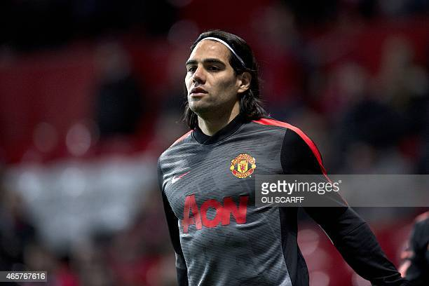 Manchester United's Colombian striker Radamel Falcao warmsup ahead of the FA Cup quarterfinal football match between Manchester United and Arsenal at...