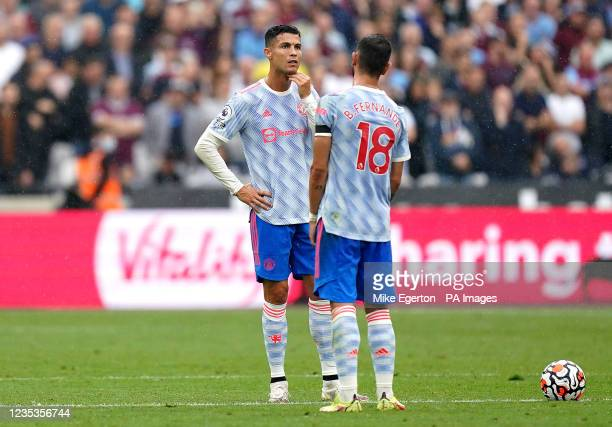 Manchester United's Cristiano Ronaldo and Bruno Fernandes looks dejected after West Ham United's Said Benrahma scores their side's first goal of the...