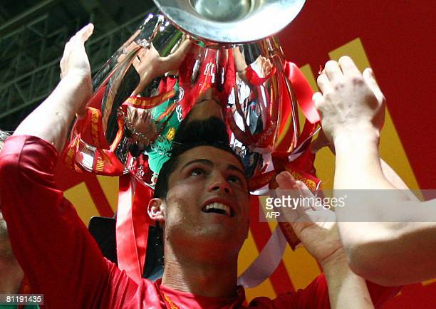 Manchester United's Cristiano Ronaldo celebrates with the trophy after beating Chelsea in the final of the UEFA Champions League football match at...