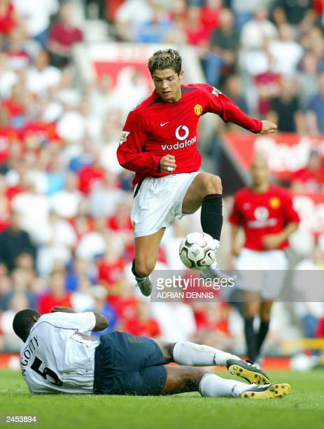 Manchester United's Cristiano Ronaldo jumps over a tackle from Bruno N'Gotty of Bolton Wanderers during the first Premiership match of the season at...