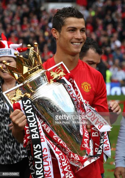 Manchester United's Cristiano Ronaldo lifts the Barclays Premier League trophy
