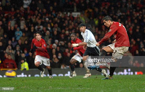 Manchester United's Cristiano Ronaldo scores to make it 41 against Derby 08 December 2007 during their Premiership clash at Old Trafford Manchester...