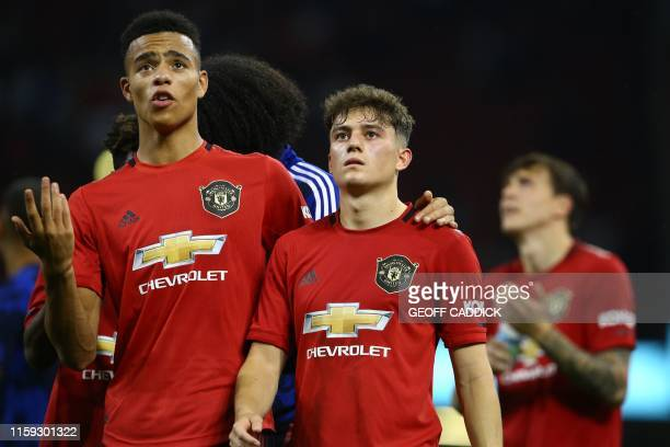 Manchester United's Daniel James and Manchester United's English striker Mason Greenwood celebrates victory during the 2019 International Champions...