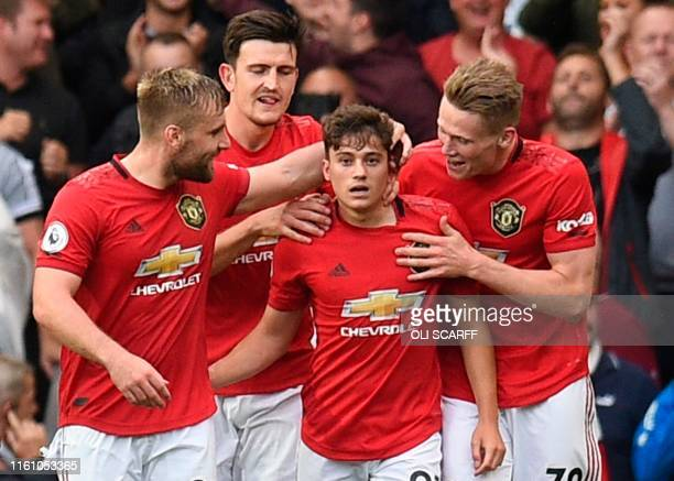 Manchester United's Daniel James celebrates with teammates after scoring their fourth goal on his premier league debut during the English Premier...