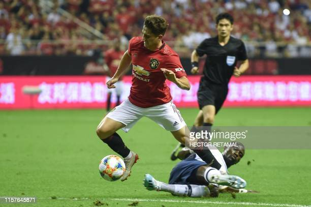 Manchester United's Daniel James fights for the ball with Tottenham's Moussa Sissoko during the International Champions Cup football tournament...