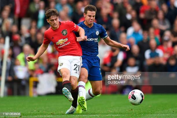 Manchester United's Daniel James vies with Chelsea's Spanish defender Cesar Azpilicueta during the English Premier League football match between...