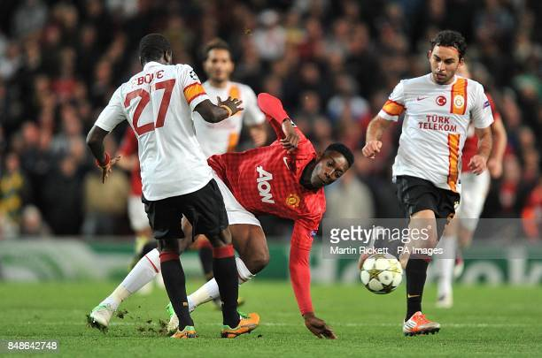 Manchester United's Danny Welbeck collides with Galatasaray's Emmanuel Eboue as they battle for the ball during the UEFA Champions League Group H...