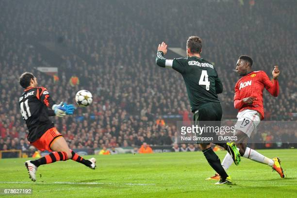 Manchester United's Danny Welbeck has a shot on target past Real Madrid goalkeeper Diego Lopez and Sergio Ramos