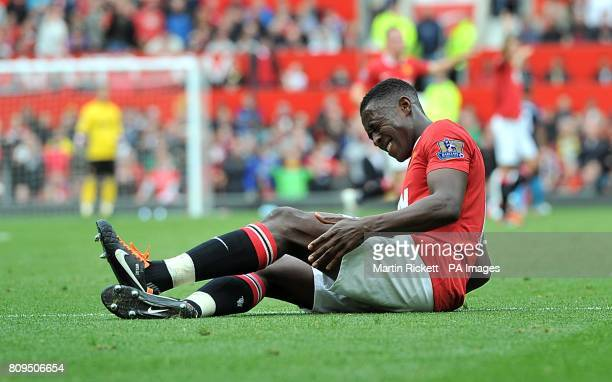 Manchester United's Danny Welbeck holds hi left hamstring after he picks up an injury