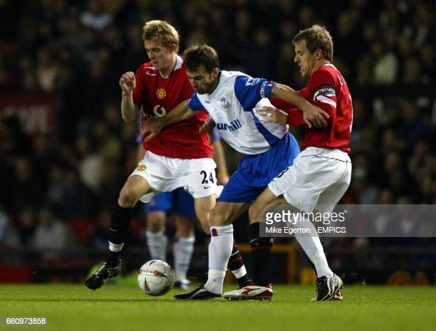 Manchester United's Darren Fletcher and Phil Neville and Crystal Palace's Dougie Freedman