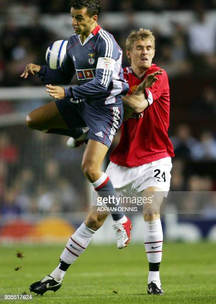 Manchester United's Darren Fletcher challenges Benfica's Sabrosa Simao for the ball during the Champions League Group D football match at Old...