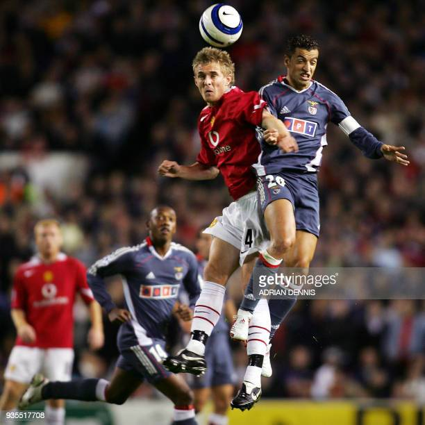 Manchester United's Darren Fletcher challenges for the ball against Benfica's Sabrosa Simao during the Champions League Group D football match at Old...