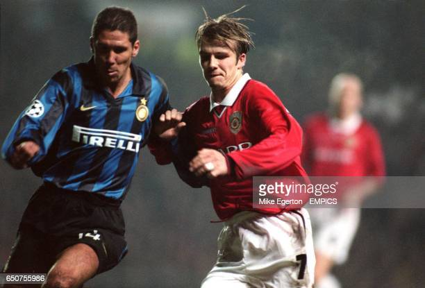 Manchester United's David Beckham battles with Inter Milan's Diego Simeone during the UEFA Champions League match