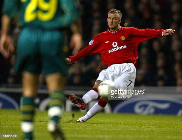 Manchester United's David Beckham hits a free kick to score an equalizer against Nantes during a phase two group A champions league match at Old...