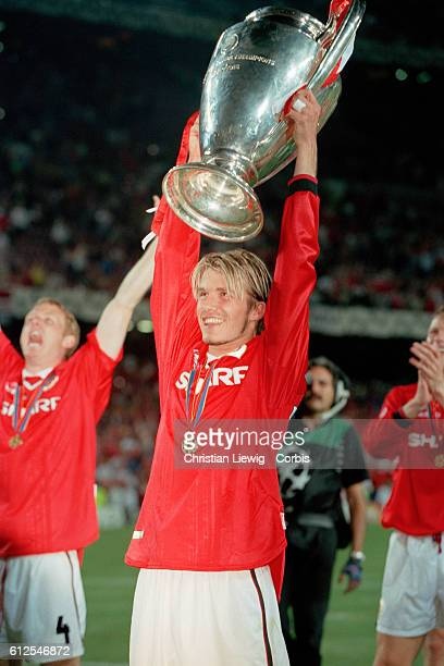 Manchester United's David Beckham hoists the trophy aloft after the 19981999 Champions League final won by Manchester United 21 | Location Barcelona...