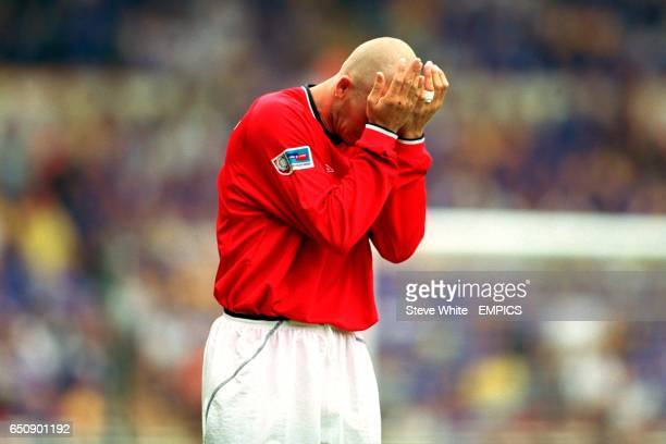 Manchester United's David Beckham holds his head in his hands after losing to Chelsea in the Charity Shield
