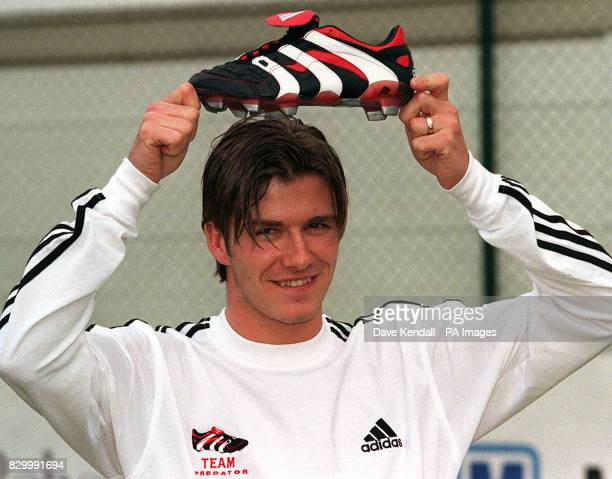 Manchester United's David Beckham poses for the media during a photocall in Stockport today where he launched Adidas 'Predator' the latest in...