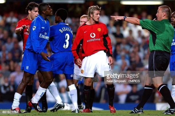 Manchester United's David Beckham shows his frusteration at referee Graham Poll's decision