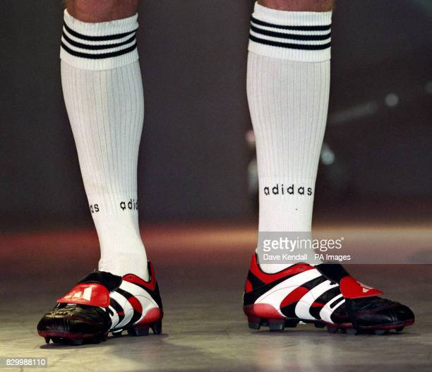 Manchester United's David Beckham wearing a pair of Adidas 'Predator' the latest in football technology which he launched during a photocall in...