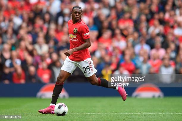 Manchester United's defender Aaron WanBissaka runs with the ball on his premier league debut during the English Premier League football match between...