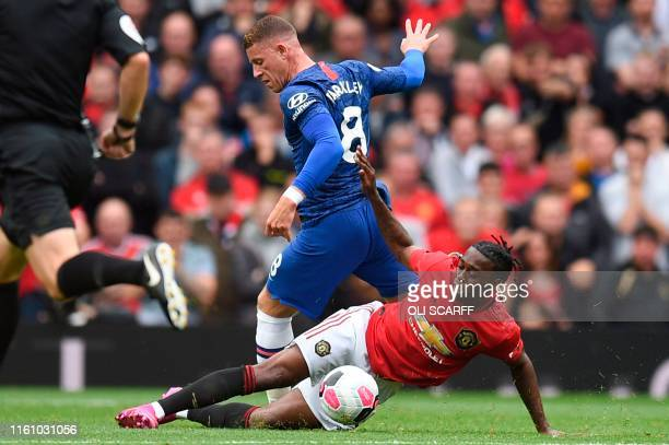 Manchester United's defender Aaron WanBissaka tackles Chelsea's English midfielder Ross Barkley during the English Premier League football match...
