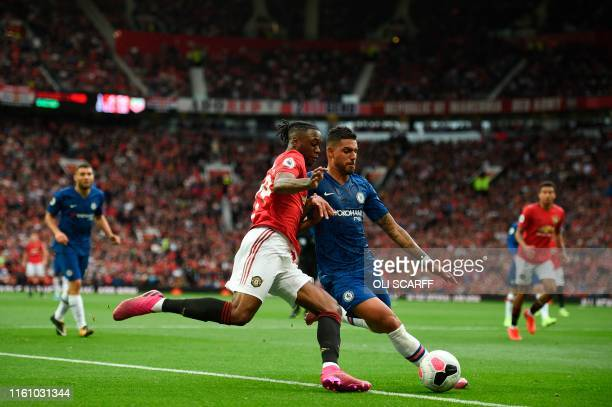 TOPSHOT Manchester United's defender Aaron WanBissaka vies with Chelsea's BrazilianItalian defender Emerson Palmieri during the English Premier...