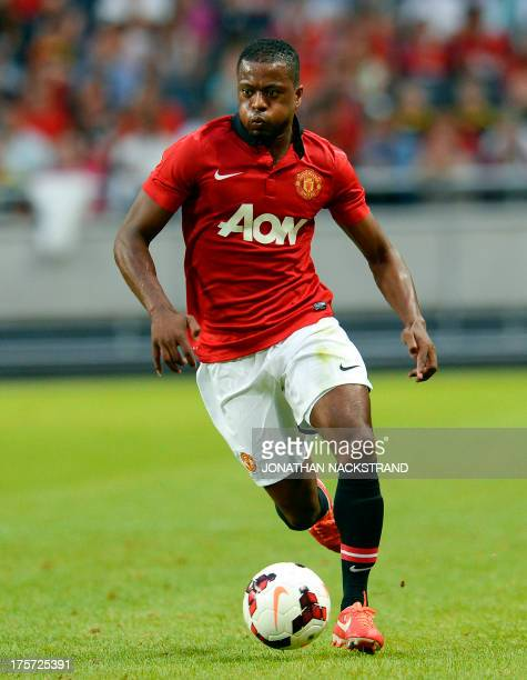 Manchester United's defender Patrice Evra controls the ball during a friendly football match between AIK and Manchester United on August 6 2013 at...
