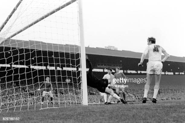 Manchester United's Denis Law and Brian Kidd watch as their winning goal scored by George Best beats Real Madrid goalkeeper Antonio Betancourt