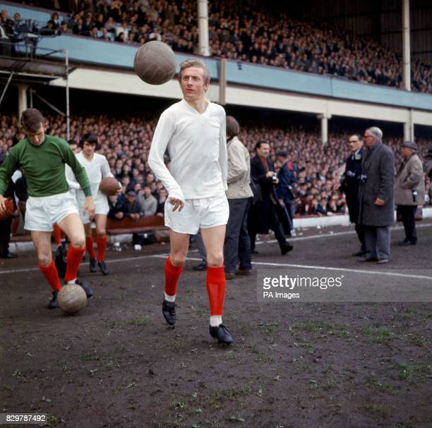 Manchester United's Denis Law keeps his eyes on the ball as he walks out onto the pitch before the game followed by teammates Alex Stepney and George...